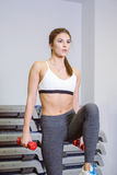 Fitness, girl takes a step aerobics with dumbbells. Fitness, the girl does step aerobics in the gym with dumbbells. The concept of health, sports Stock Photo