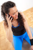 Fitness girl talking on the phone Royalty Free Stock Image