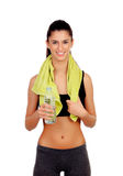 Fitness girl with a towel drinking water Stock Photo