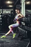 Fitness girl with towel and shaker relaxing in the gym stock photography