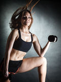 Fitness girl training shoulder muscles lifting dumbbells Royalty Free Stock Images