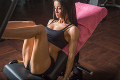 Fitness girl trains her legs pumping Stock Photo