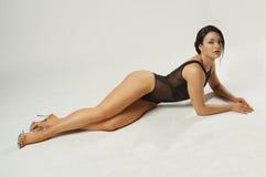 Fitness girl in transparent black bodysuit Stock Images