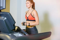 Fitness girl on the treadmill. The concept of health, sports Royalty Free Stock Photo