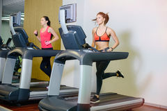 Fitness girl on the treadmill. The concept of health, sports Royalty Free Stock Photography