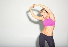 Fitness Girl Warming Up Stock Photography