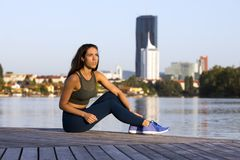 Fitness girl wearing leggings and sneakers stock photography