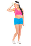 Fitness girl wiping with towel Royalty Free Stock Images