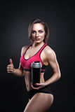Fitness Girl With Shaker On A Dark Background Stock Photo