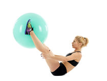 Fitness girl working with gym ball Stock Images