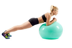 Fitness girl working with gym ball Stock Photos
