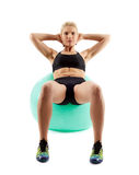 Fitness girl working with gym ball Royalty Free Stock Photography