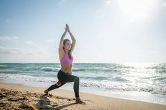 Fitness Girl working out on the beach stock image