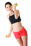 Fitness girl is working out with dumbbells Stock Image