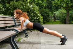 Fitness girl is working out in the park Royalty Free Stock Image