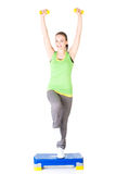 Fitness girl is working out with stepper Royalty Free Stock Images