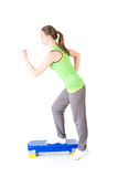 Fitness girl is working out with stepper Stock Photo