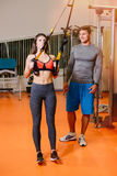 Fitness girl with  working with a trainer. The concept of health, sports Stock Photography