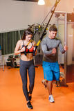 Fitness girl with  working with a trainer. Fitness girl with working with a trainer . The concept of health, sports Royalty Free Stock Photo