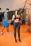 Fitness girl with  working with a trainer. The concept of health, sports Stock Image