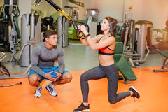 Fitness girl with  working with a trainer. The concept of health, sports Royalty Free Stock Images