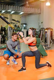 Fitness girl with  working with a trainer. The concept of health, sports Stock Images