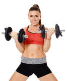 Fitness girl working with weights Stock Images
