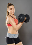 Fitness girl working with weights Royalty Free Stock Photo