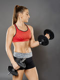 Fitness girl working with weights Stock Image