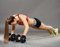 Fitness girl working with weights Royalty Free Stock Photos