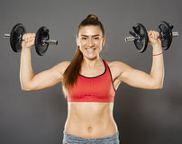 Fitness girl working with weights Stock Photo