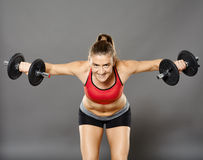 Fitness girl working with weights Stock Photos