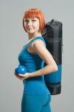 Fitness girl with yoga mat Stock Photos