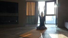 Fitness girl yoga silhouette in the room stock footage