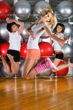 Fitness girls. Young woman in sport training at fitness center stock images