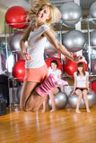 Fitness girls. Young woman in sport training at fitness center royalty free stock images