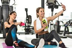 Fitness girls taking selfie royalty free stock photo