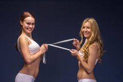 Fitness girls in underwear with meter tape. Diet and fitness concept healthy lifestyle Stock Image