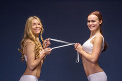 Fitness girls in underwear with meter tape. Diet and fitness concept healthy lifestyle Stock Photos