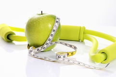 Fitness green apple Stock Images