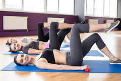 Fitness. Group of active smiling women are training in fitness club with dumbbells. Smiling and looking at the camera Stock Photos