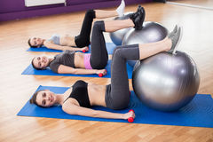 Fitness. Group of active smiling women are training in fitness club with exercise balls and dumbbells. Smiling and looking at the camera Stock Photography