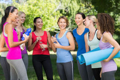 Fitness group chatting in park Stock Photo