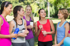 Fitness group chatting in park Stock Images