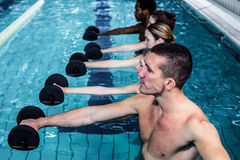 Fitness group doing aqua aerobics. In the pool Royalty Free Stock Photos
