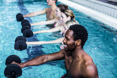 Fitness group doing aqua aerobics. In the pool Royalty Free Stock Images