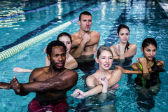 Fitness group doing aqua aerobics. In the pool Stock Photo