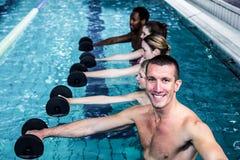 Fitness group doing aqua aerobics. In the pool Stock Photos