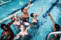 Fitness group doing aqua aerobics Stock Images