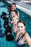 Fitness group doing aqua aerobics Royalty Free Stock Photo